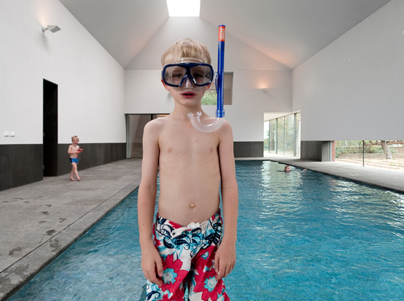indoor pool with boy